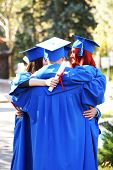 pic of graduation hat  - Graduate students wearing graduation hat and gown - JPG