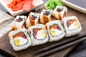 Sushi roll with salmon, tuna and eel