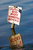 Sign in a lake (Please do not throw rocks) poster