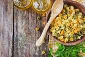stock photo of italian parsley  - colorful pasta in a wooden bowl vegetable oil and parsley on the old wooden background - JPG
