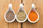 Three Kinds Of Lentil In Bowls - Red Lentil, Green Lentil And Brown Lentil