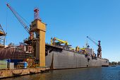 stock photo of shipbuilding  - Dry floating dock and cranes in shipyard - JPG