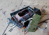 pic of televisor  - Old broken television on the concrete floor - JPG