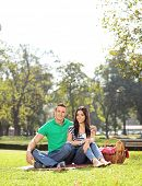 Young couple posing on a picnic in park on a sunny day shot with a tilt and shift lens