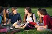 Teens Doing Homework Outdoors
