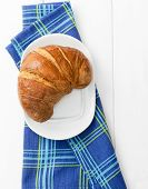 Croissant Over Bluish Cloth
