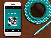 Mobile Phone With Discount Coupon, Cup Of Coffee And Pencil Lying On Desk