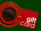 Christmas Coffee With Holy And Gift Card Lying On Tablecloth