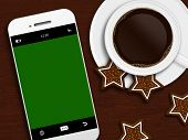 Christmas Coffee, Gingerbread And Mobile Phone Lying On Wooden Table