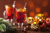 glass of mulled wine with orange and spices, christmas decoration background