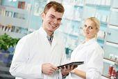 cheerful male pharmacist chemist man portrait in pharmacy drugstore