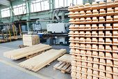 Stacked wood pine timber production for processing and furniture production at woodworking enterprise