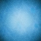 Perspective and closeup view to abstract space of empty light blue natural clean denim texture for the traditional business background in cold bright colors with diagonal shift tilt lines and stitches