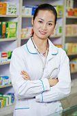 chinese pharmacist chemist woman standing in china pharmacy drugstore