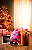 image of sun tan lotion  - Christmas sun holidays with tablet luggage sunglasses and sun lotion decorated tree on background - JPG