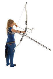 foto of longbow  - Young dirl with blue shirt and jeans shooting with a longbow - JPG