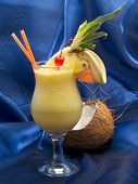 image of pina-colada  - Pina Colada cocktail isolated on blue background - JPG