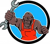 foto of ape  - Illustration of an angry gorilla ape mechanic with spanner punching facing front set inside circle on isolated background done in cartoon style - JPG