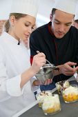 pic of pastry chef  - Chef with student in pastry making dessert - JPG