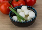 pic of shredded cheese  - Mozzarella cheese balls with onion and tomato branch - JPG