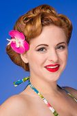 foto of redhead  - Retro styled redheaded woman with fifties hair and makeup blue background - JPG