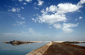 image of dike  - Building dikes on the Dead Sea in the area of factories - JPG