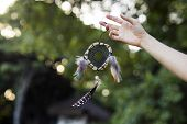 pic of dream-catcher  - Woman holding dream catcher in nature - JPG