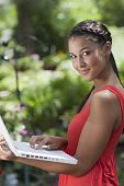 Young Woman Posing with a Laptop Outdoors
