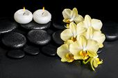 foto of yellow orchid  - beautiful spa setting of yellow orchid phalaenopsis and candles on black zen stones with drops closeup - JPG