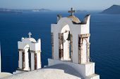 foto of blue-bell  - Blue domes and their bell tower in Oia - JPG