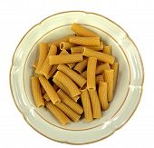 stock photo of whole-wheat  - A bowl of rigatoni whole wheat pasta on a white background - JPG