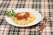stock photo of italian parsley  - Plate of spaghetti with parsley garnish - JPG