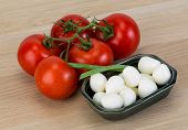 image of shredded cheese  - Mozzarella cheese balls with onion and tomato branch - JPG