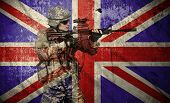 foto of rifle  - soldier holding rifle on a England flag background double exposure - JPG