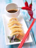 foto of soy sauce  - Fried asian wonton with soy sauce - JPG