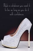 stock photo of stiletto heels  - High heel silver with rhinestone stiletto shoe with Style is Whatever You Want quote on white wood table and black background - JPG
