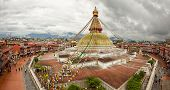 pic of buddhist  - Sacred Boudhanath buddhist stupa and adjacent buildings in Kathmandu of Nepal against Cloudy Sky shot from above - JPG