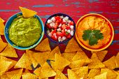 image of nachos  - Mexican food nachos guacamole pico de gallo and dipping cheddar cheese - JPG