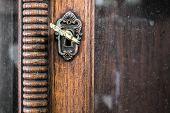 stock photo of keyhole  - Vintage keyhole with key on vintage wooden cabinet with white background - JPG