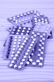 stock photo of oral  - Oral contraceptive pill strips on pine wood table - JPG