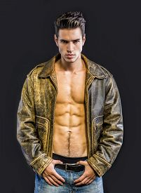 stock photo of jacket  - Handsome young man wearing leather jacket on naked torso - JPG