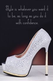 stock photo of stiletto  - High heel silver with rhinestone stiletto shoe with Style is Whatever You Want quote on white wood table and black background - JPG