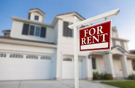 stock photo of in front  - Red For Rent Real Estate Sign in Front of Beautiful House - JPG