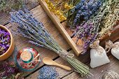 Bunch Of Lavender And Medicinal Herbs, Mortar Of Dry Healthy Flowers On Wooden Table. Herbal Medicin poster
