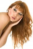 Beautiful Redheaded Topless Woman Letting Down Her Hair On White Background