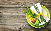 Easter table setting with daffodil and cutlery. Holidays background poster