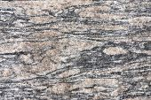 foto of gneiss  - Background of the metamorphic rock type augen gneiss - JPG