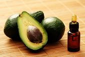 bottle of avocado essential oil - beauty treatment