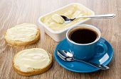 Melted Cheese, Spoon In Plastic Container, Sandwiches With Melted Cheese, Coffee In Blue Cup On Sauc poster