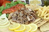 stock photo of souvlaki  - Plate of traditional Greek gyros or Turkish kebab with meat - JPG
